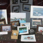photos and paintings in one of the gallery front windows
